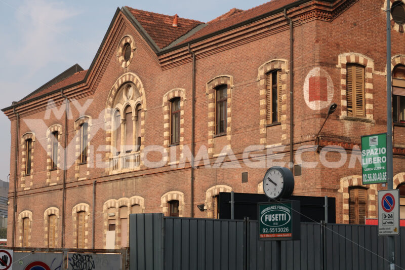 Buildings of the major hospital of Milan, Ca 'Granda Foundation. Signboard of funeral home agency. - MyVideoimage.com