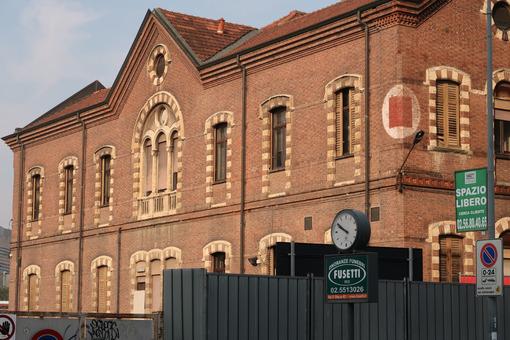 Buildings of the major hospital of Milan, Ca 'Granda Foundation. Signboard of funeral home agency. - MyVideoimage.com