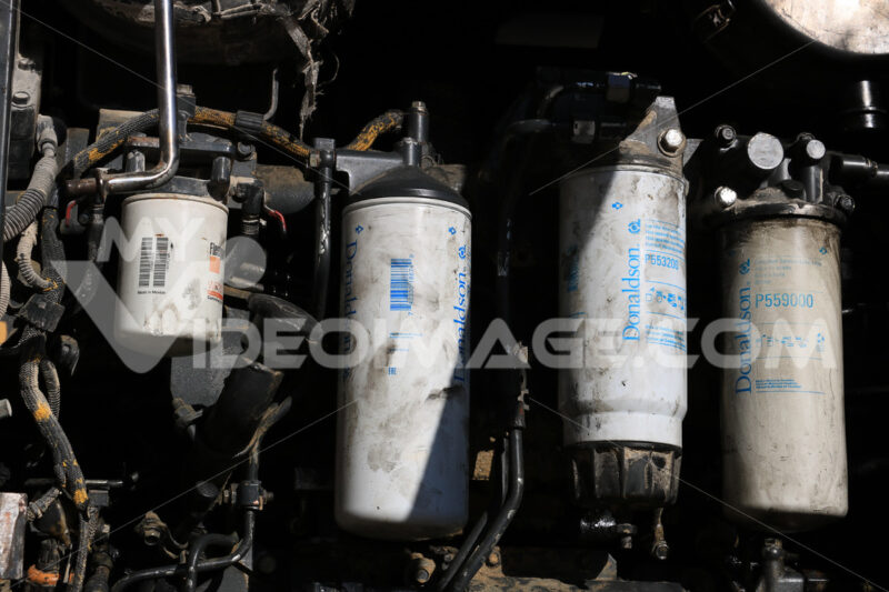 Bulldozer engine. Engine and mechanical parts of a bulldozer. - MyVideoimage.com | Foto stock & Video footage