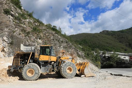 Bulldozer in a Carrara marble quarry. A large Komatsu mechanical - MyVideoimage.com