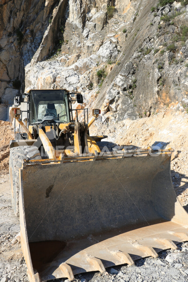 Bulldozer in a Carrara marble quarry. A large  mechanical shovel - MyVideoimage.com