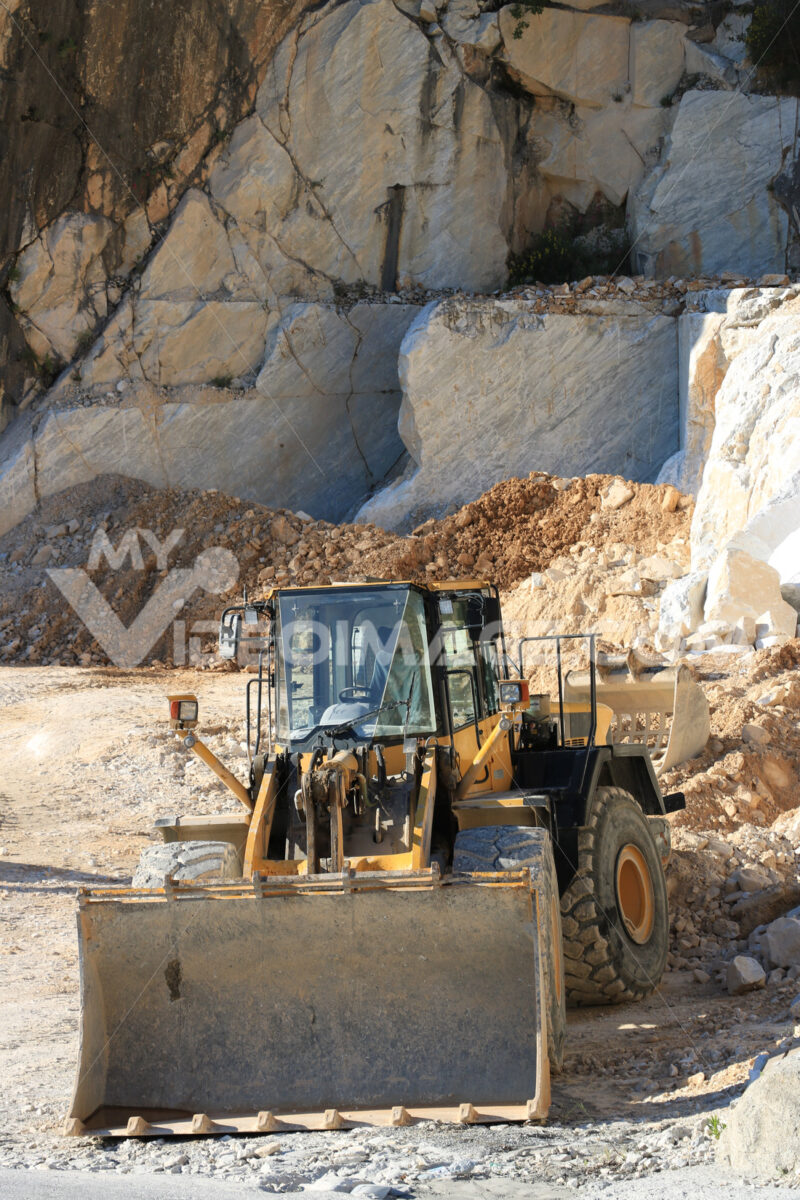 Bulldozer in a Carrara marble quarry. A large mechanical shovel. Cave di marmo. - LEphotoart.com