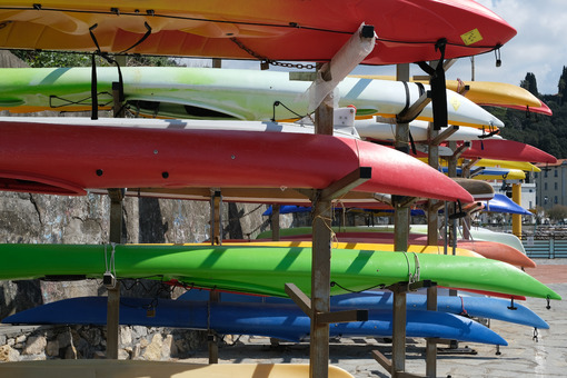 Canoes stacked during the winter time by the sea. - MyVideoimage.com | Foto stock & Video footage