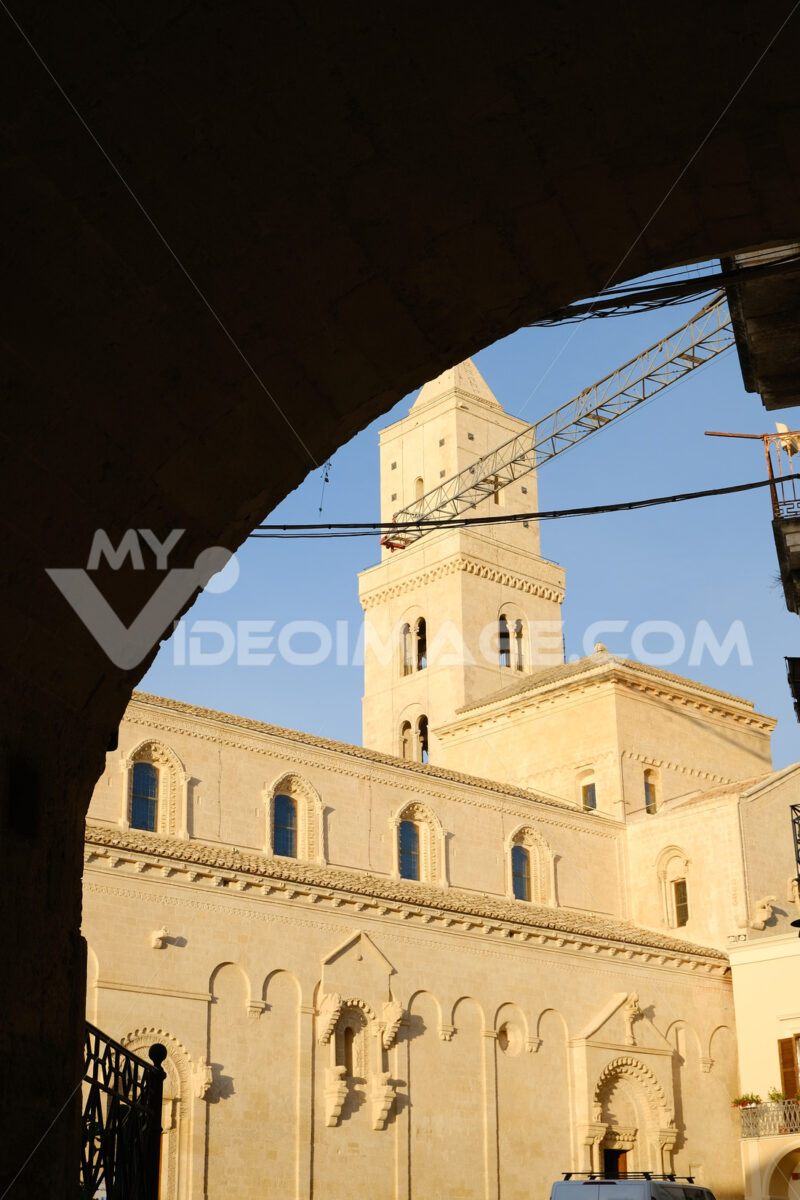Cathedral Church of the Madonna della Bruna and of Sant'Eustachio in Matera. Built in tuff stone. Sunset light. Matera foto. - LEphotoart.com
