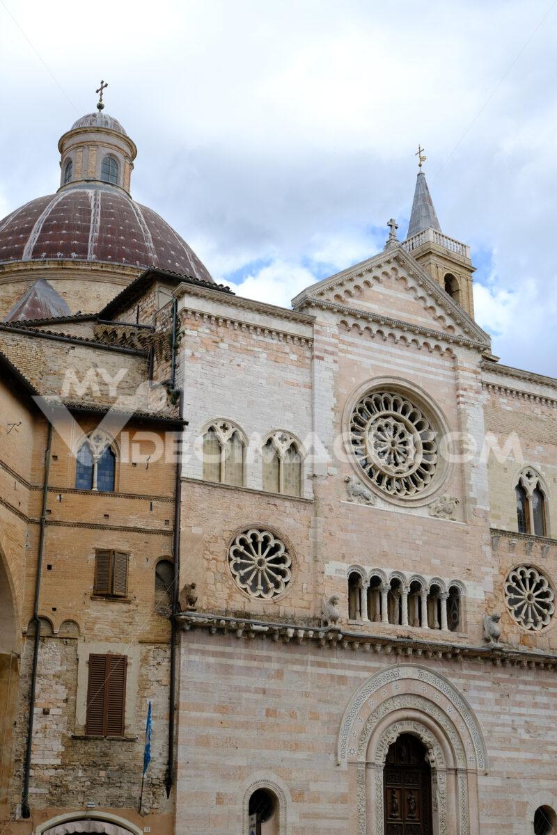Cathedral of San Feliciano in Foligno with historic buildings. The Romanesque church with stone facades in Piazza della Repubblica. - MyVideoimage.com