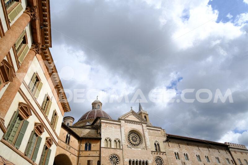 Cathedral of San Feliciano in Foligno with historic buildings. The Romanesque church with stone facades in Piazza della Repubblica. - LEphotoart.com