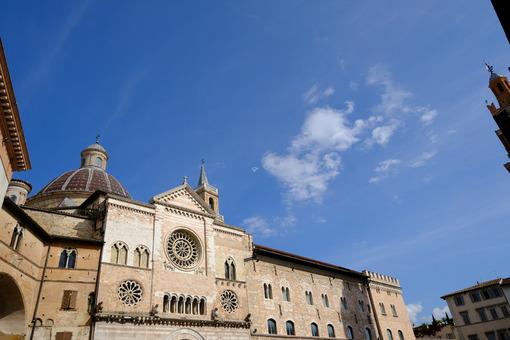 Cathedral of San Feliciano in Foligno with historic buildings. The Romanesque church with stone facades in Piazza della Repubblica. Città italiane. Italian cities.