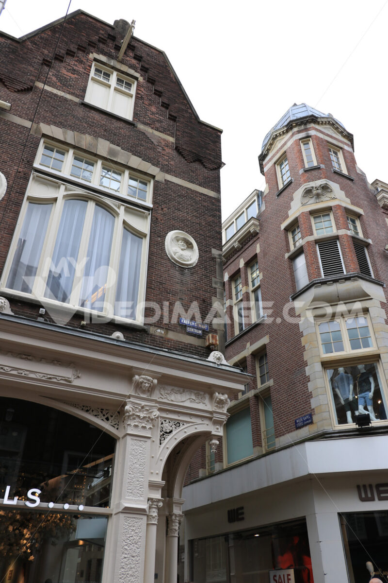 Characteristic and picturesque houses in the city center. Brick facades with white windows. Decorations on the facade. - MyVideoimage.com