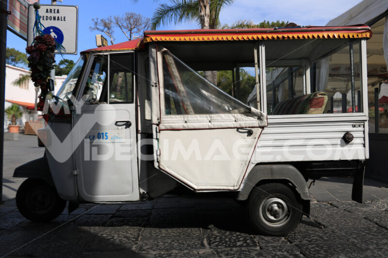 Characteristic taxi with motorcycle Ape parked on a street in Is - MyVideoimage.com