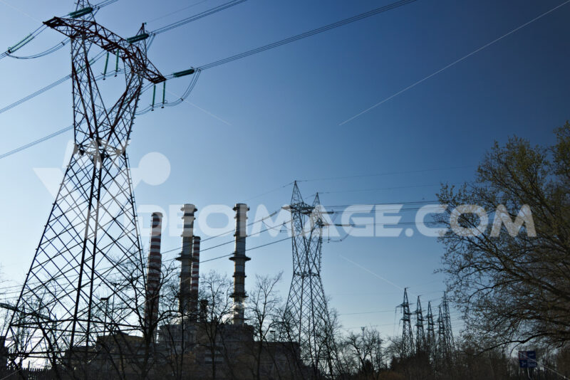 Chimneys, pylons and cables of the power plant. - MyVideoimage.com
