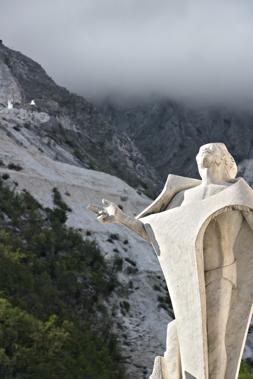 Christ of the quarryman. Colonnata. Marble quarries in Colonnata and monument to the quarryman.  The town is famous for the lardo di Colonnata and for the extraction of the white Carrara marble. Colonnata, Carrara, Tuscany, Italy. - MyVideoimage.com | Foto stock & Video footage