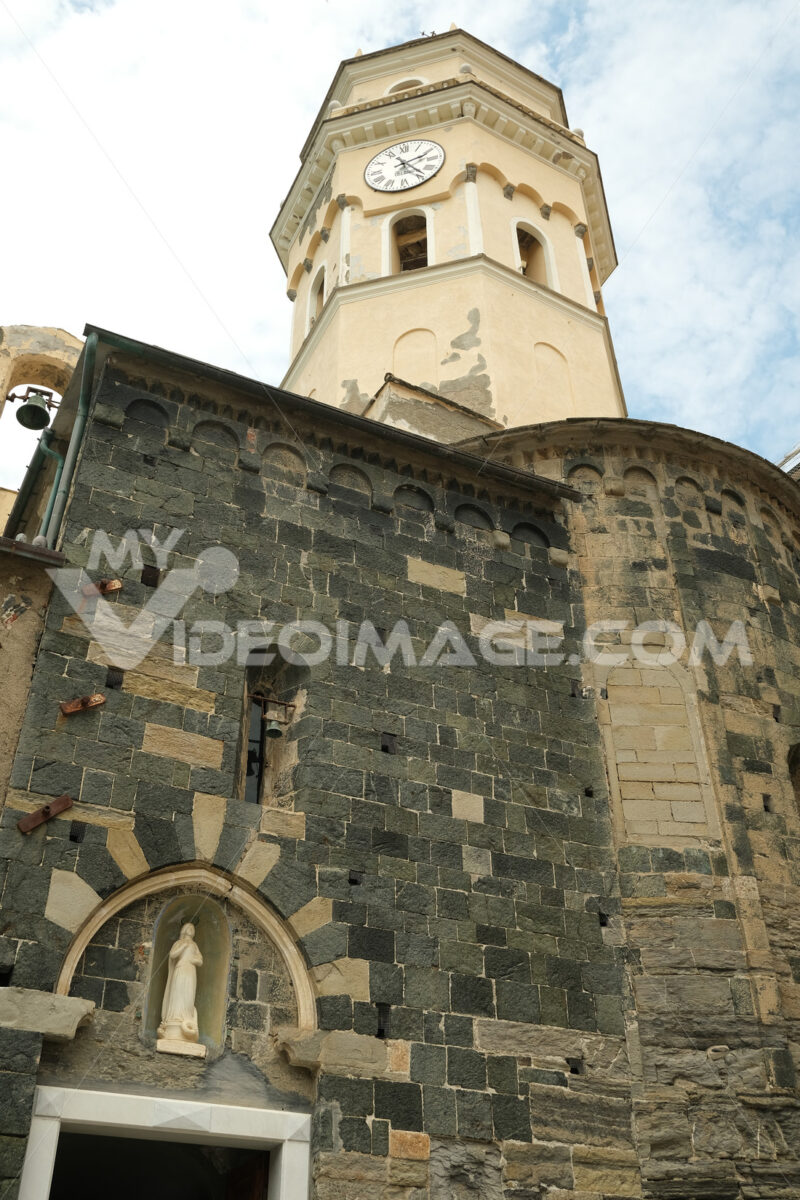 Church and bell tower in the seaside village. Royalty free photography. Città italiane. Italian cities.