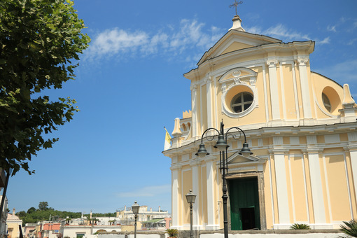 Church in Ischia Porto. Church facade on the background of blue. Foto Ischia photos.