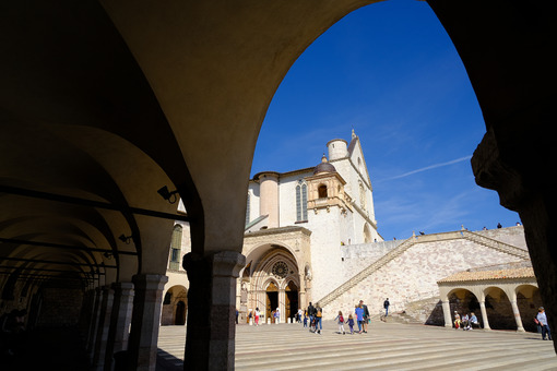 Church of San Francesco in Assisi and the square with the arcade. The basilica built in Gothic style consists of a lower and an upper church. - LEphotoart.com
