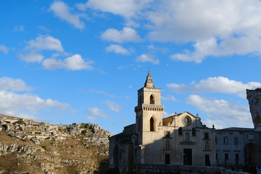Church of San Pietro Caveoso in Matera. In the background the Mountains with ancient prehistoric caves. - MyVideoimage.com
