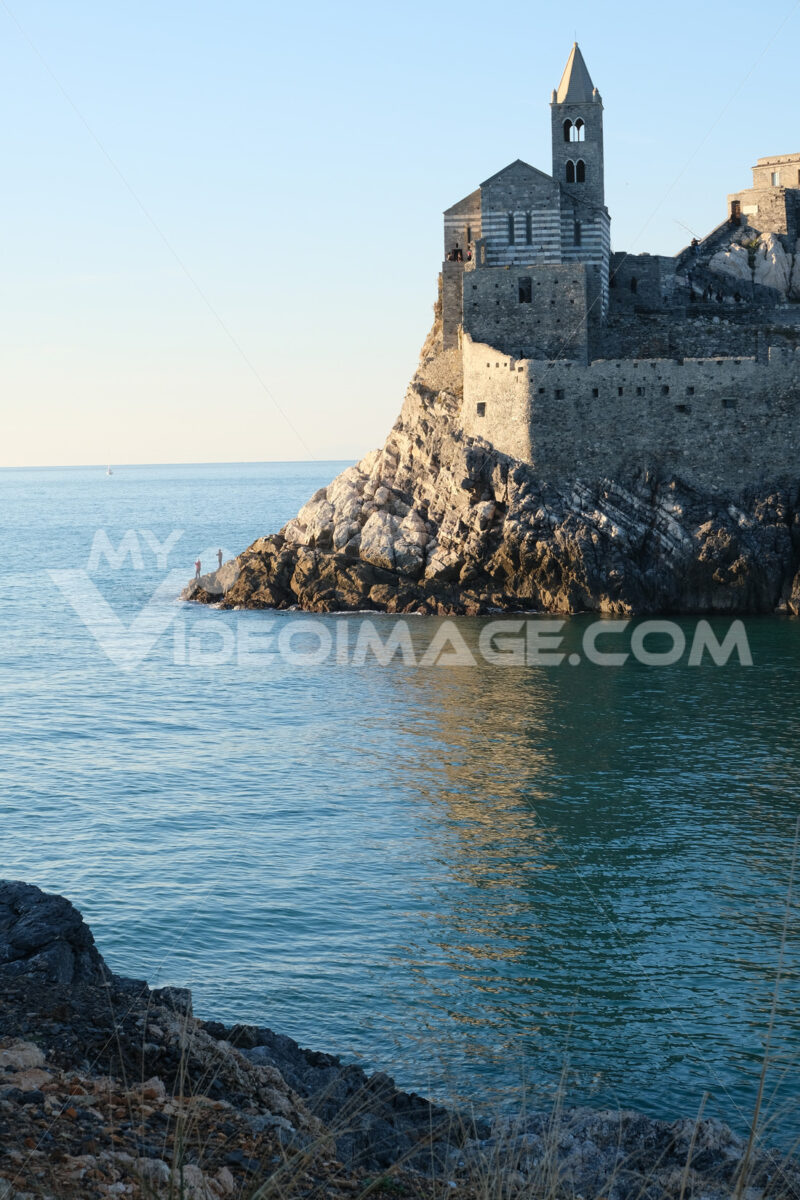 Church of San Pietro in Portovenere near the Cinque Terre. Ancient medieval building on the rocks overlooking the sea. - MyVideoimage.com