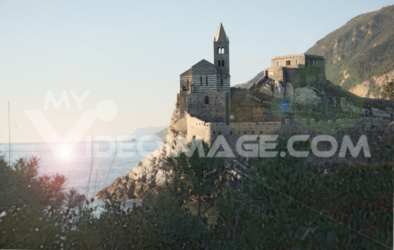 Church of San Pietro in Portovenere near the Cinque Terre. Ancient medieval building on the rocks overlooking the sea. Sunset - MyVideoimage.com