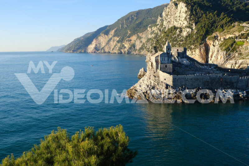 Church of San Pietro in Portovenere near the Cinque Terre. Sea and rocks overhanging the Ligurian sea in Italy. - MyVideoimage.com