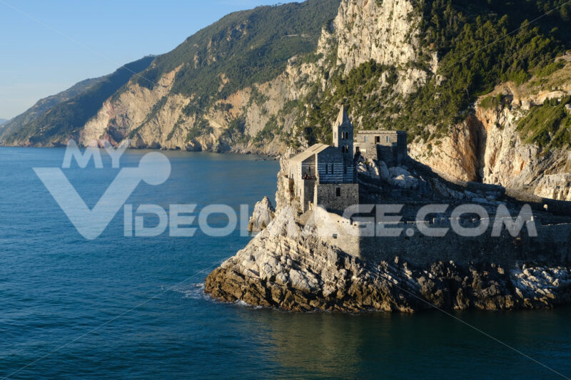 Church of San Pietro in Portovenere on the rocks overlooking the sea. Ancient medieval building near the Cinque Terre in Liguri. Italy. - MyVideoimage.com
