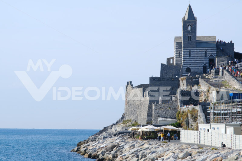 Church of San Pietro in Portovenere overlooking the sea. The ancient church built in white and gray stone is world famous. - MyVideoimage.com