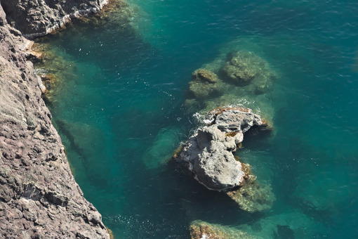 Cinque Terre, lIguria, Italy. Rocks overlooking the blue sea - MyVideimage.com