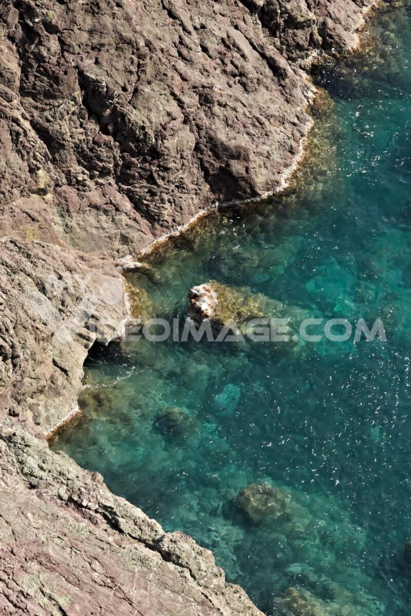 Cinque Terre, lIguria, Italy. Rocks overlooking the blue sea - MyVideimage.com