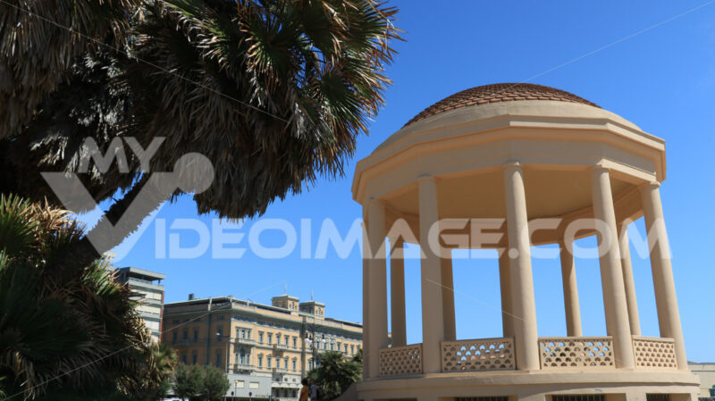 Circular gazebo temple of music near the Mascagni terrace. The small building is built near the sea and the aquarium. - MyVideoimage.com