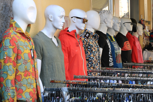 Clothing store mannequins with colorful shirts and dresses. - MyVideoimage.com