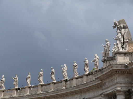 Cloudy sky over the statues of the colonnade of St. Peter's Square in the Vatican. - MyVideoimage.com