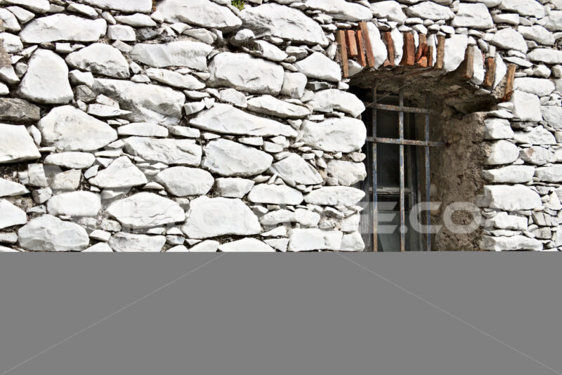 Colonnata, Carrara, Tuscany. Detail of windows and walls made of white marble extracted from the nearby quarries. - MyVideoimage.com