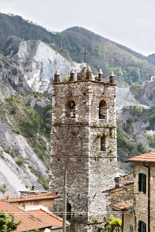 Colonnata Italy. Bell tower. Bell tower of the church built with white marble pebbles.   Colonnata, Carrara, Tuscany, Italy. - MyVideoimage.com | Foto stock & Video footage