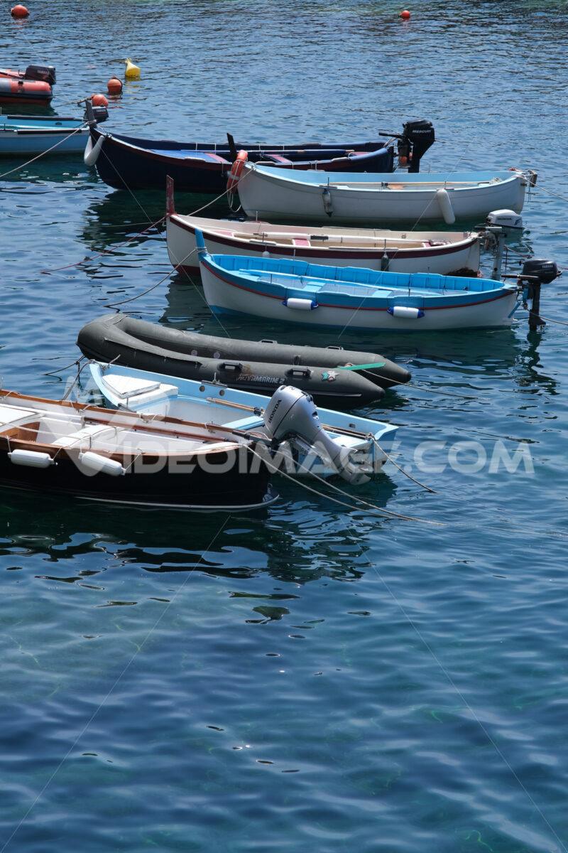 Colored boats on the blue sea. Riomaggiore, Cinque Terre. Stock Photos. - MyVideimage.com