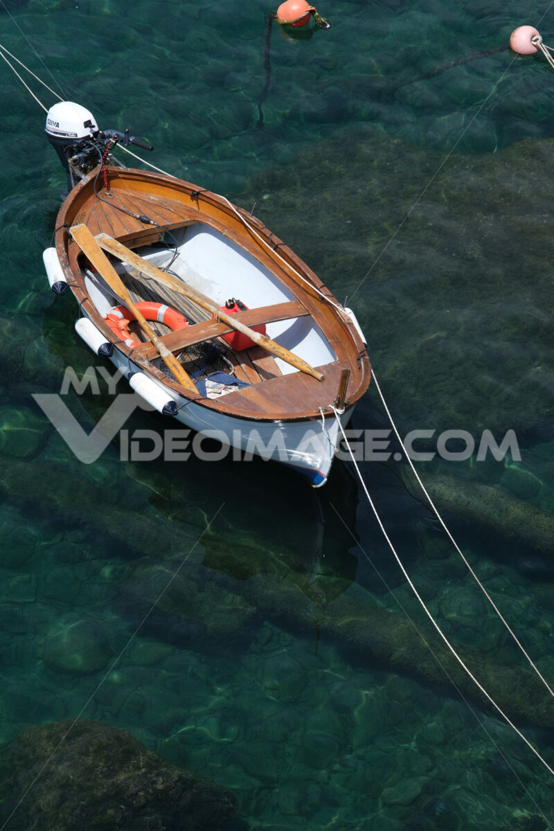 Colored boats on the blue sea. Riomaggiore, Cinque Terre. Stock Photos. Sfondo mare. - MyVideoimage.com