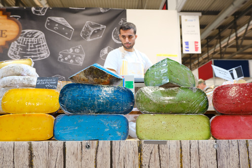 Colorful French cheeses in a stand at the craft fair. - MyVideoimage.com