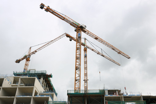 Construction site with cranes in Amsterdam. Construction of a ne - MyVideoimage.com