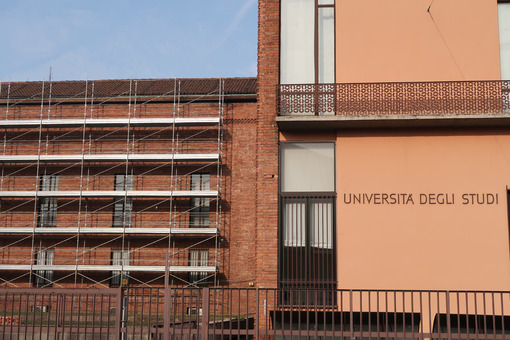 Construction site with scaffolding on the facade of a historic building of the University of Milan. - MyVideoimage.com