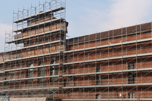Construction site with scaffolding on the facade of a historic building to  Milan. Cantieri edili. - LEphotoart.com