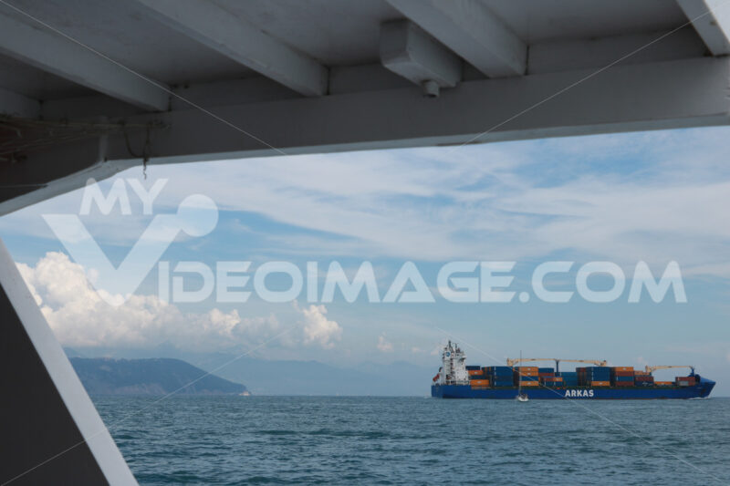 Container ship leaving the port of La Spezia. - MyVideoimage.com