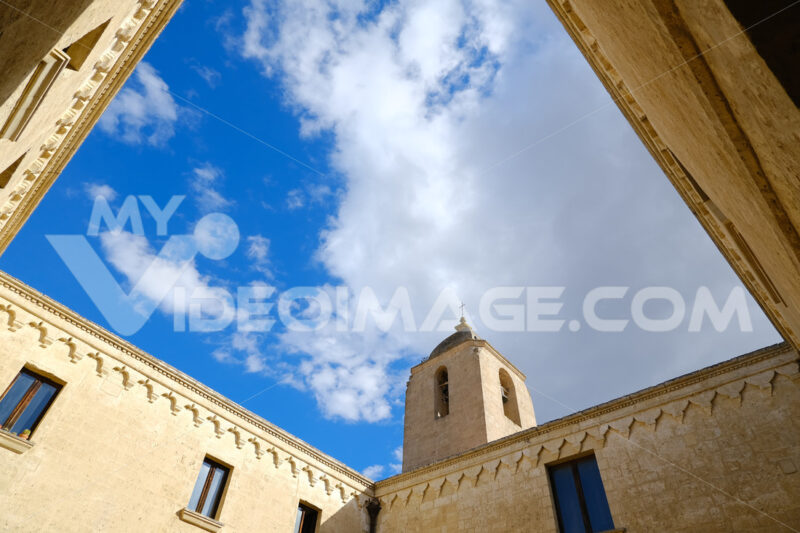 Convent of Sant'Agostino in Matera. Beige stone facade with blue sky and clouds. - MyVideoimage.com