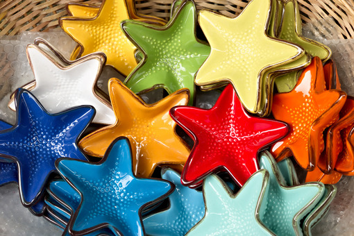 Corniglia, Cinque Terre. Handmade ceramic decorations representing colored sea stars - MyVideoimage.com