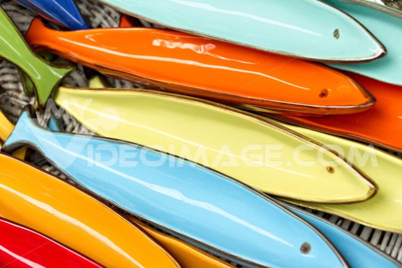 Corniglia, Cinque Terre. Handmade ceramic decorations representing colored sea stars - MyVideoimage.com