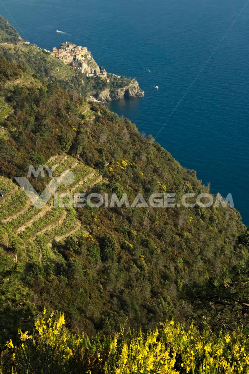 Corniglia to the Cinque Terre. Seascape at sunset time. A fog ri - MyVideimage.com