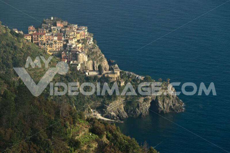 Corniglia to the Cinque Terre. Seascape at sunset time. Fog. Stock photo royalty free - LEphotoart.com
