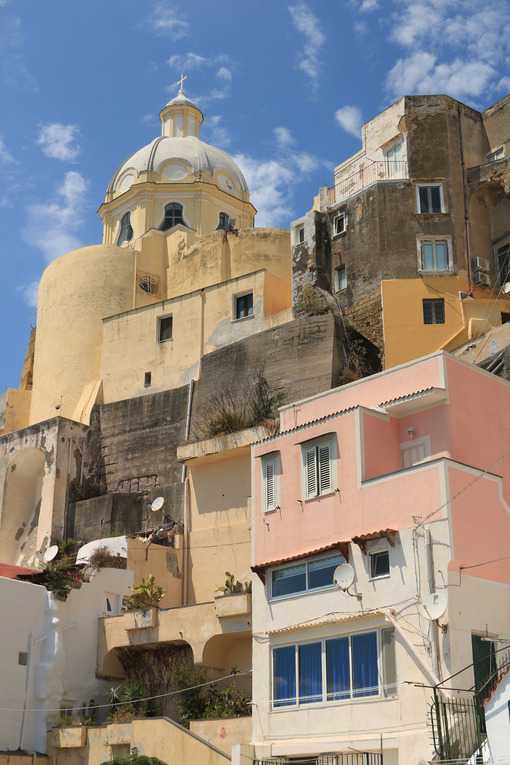 Corricella Procida. Village of Marina Corricella, Procida Island, Mediterranean Sea, near Naples. Colorful houses in the fishing village and boats anchored in the harbor. - MyVideoimage.com | Foto stock & Video footage