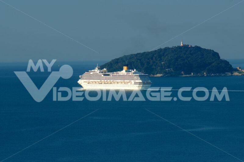 Costa Pacifica cruise ship sailing in the Mediterranean sea. Gulf of La Spezia in Liguria with the island of Tino. - LEphotoart.com