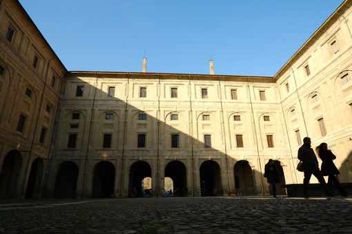 Courtyard in the Palazzo della Pilotta in Parma. The building is built of terracotta bricks. - MyVideoimage.com