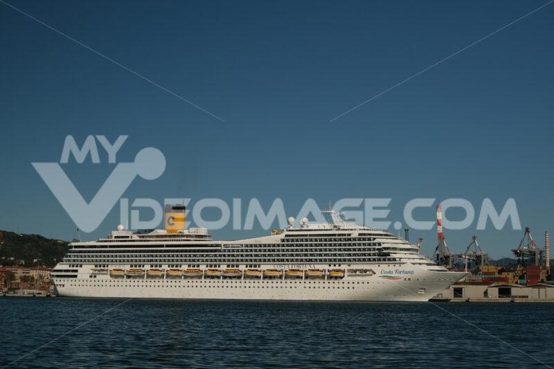 Cruise ship Costa Fortuna anchored at the Port of La Spezia in Liguria. Sky and blue sea background. Navi - LEphotoart.com