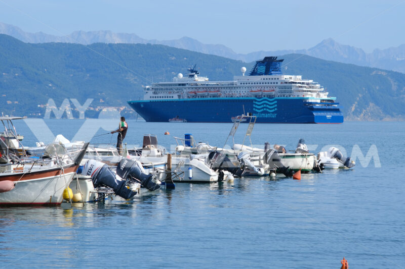 Cruise ship anchored in the Gulf of La Spezia opposite Portovenere. In the foreground boats moored at the port, near the Cinque Terre. Foto navi. Ships photo.