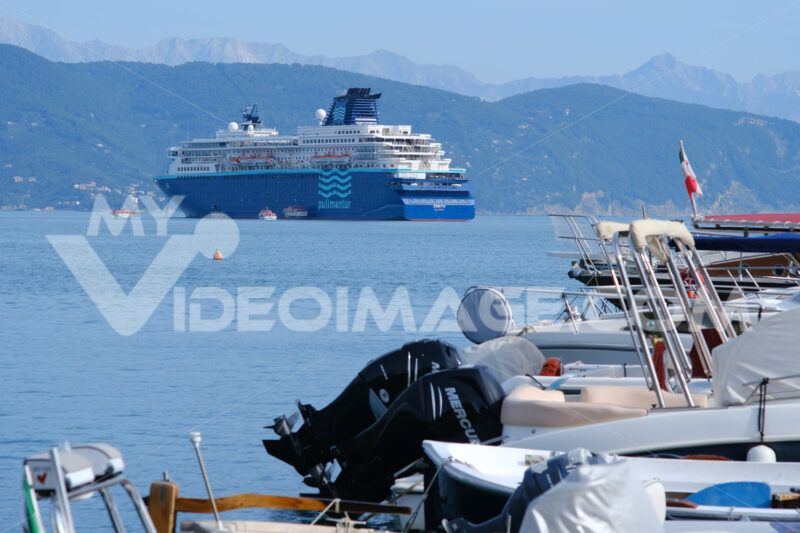 Cruise ship anchored in the Gulf of La Spezia opposite Portovenere. In the foreground boats moored at the port, near the Cinque Terre. - LEphotoart.com