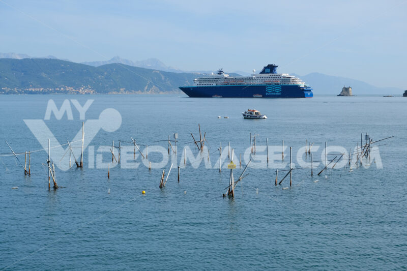 Cruise ship anchored in the Gulf of La Spezia opposite Portovenere. In the foreground, plant for the cultivation of mussels. Foto navi. Ships photo.